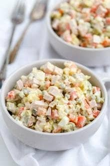 Russian Salad in a bowl, another bowl in background