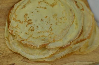 Cooked crepes on a cutting board