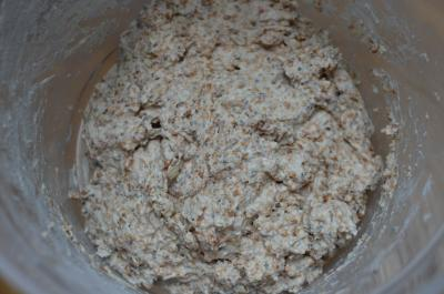 All ingredients for easy whole wheat baguette dough combined together in a bowl