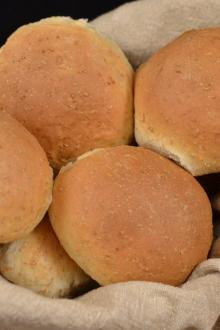 Quick Wheat Buns in a towel covered basket