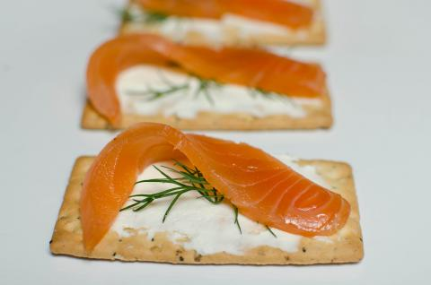 Cold Smoked Salmon on a cracker with cream cheese and dill