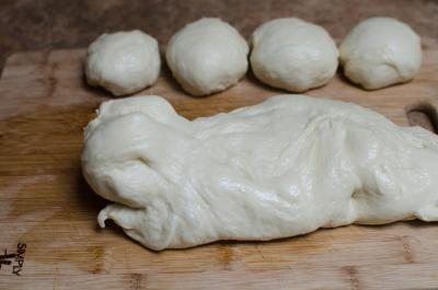 Dough being rolled out into small balls on the cutting board