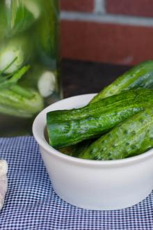 Pickled cucumbers in a jar and in a bowl