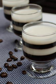 Espresso Jello Shots on a kitchen towel with coffee beans spread on the table