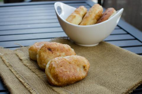 Overnight Piroshky on a table mat and some in a bowl