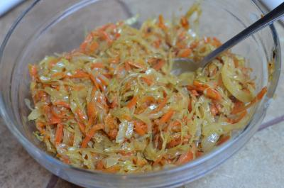 Sautéed onions, carrots and cabbage in a bowl