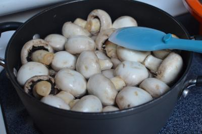 Mushrooms in a pot filled with water on the stove top