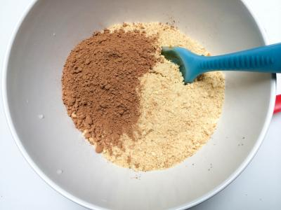 Cocoa powder and blended biscuit cookies in a bowl