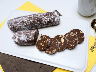 Chocolate Salami cut up into slices on a plate