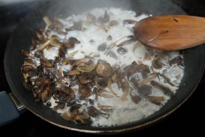 Cream added to the skillet with mushrooms and onions