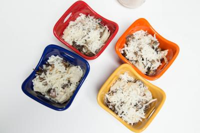 4 ramekins each with dumplings and cheese and the mushroom cream sauce on top then sprinkled with cheese