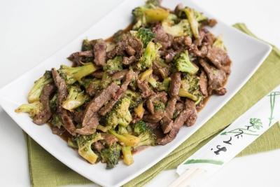 One Pot Beef & Broccoli on a plate with chopsticks next to the plate