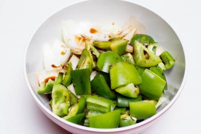 Marinate poured over green bell peppers, onions and lamb pieces