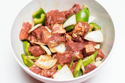 Green bell pepper, onions and lamb pieces all mixed well in the marinate