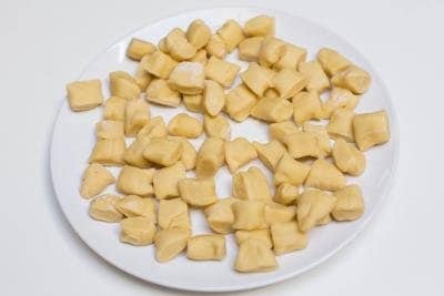 Dumplings cut in bite sized pieces laying on a plate