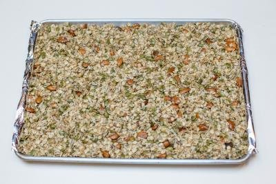 Coconut Granola Snack on a baking pan lined with foil