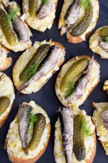 Egg & Sprats Canapes on a cutting board