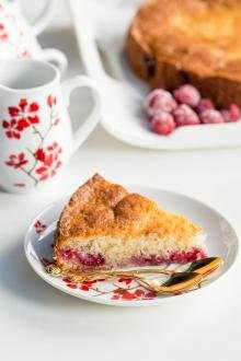 Quick Berry Coffee Cake slice on a plate with a spoon besides the slice