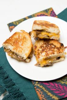 Mushroom and Cheese Sandwich on a plate cut in half