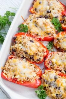 Mexican Stuffed Bell Peppers in a ceramic serving dish